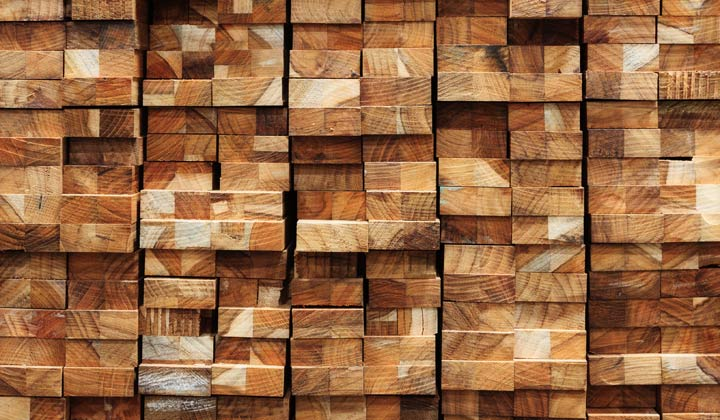 organized wall stack of wood boards