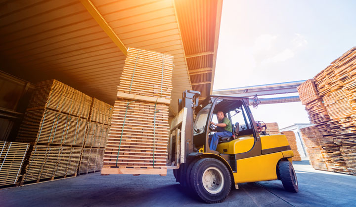 organizing lumber stacks with forklift
