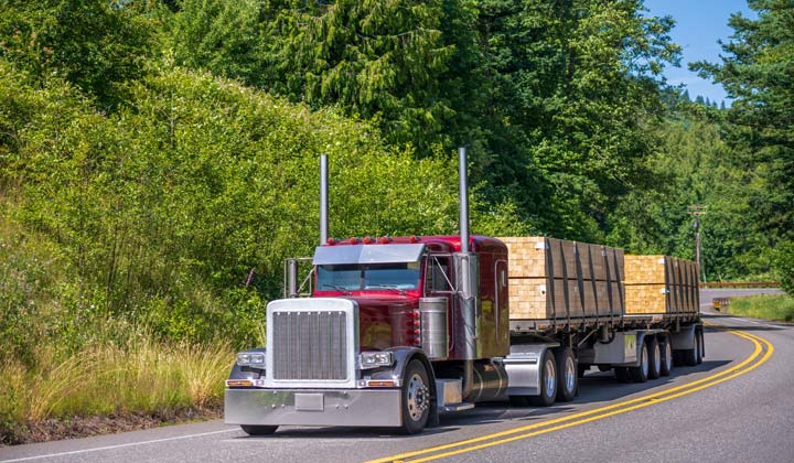 truck hauling lumber on the highway